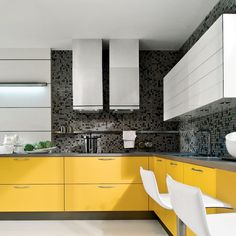 L-shaped kitchen with grey mosaic splashback tiles, white cabinetry and yellow drawers