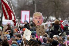 (AND WHAT DO WE CALL THE PEOPLE CARRYING SIGNS SUCH AS THIS? LOSERS!) Seen from the Capitol, there was an anti-President Trump sentiment displayed from some at the Women's March Minnesota Saturday, Jan. 21, 2017, in St. Paul, Minn. (David Joles /Star Tribune via AP)