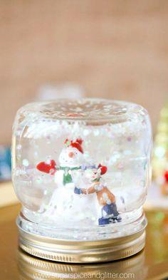 DIY Snow Globes Create your own snow globe this winter! Its a fun way to show off a festive scene save travel memories or feature your favorite character. The post DIY Snow Globes was featured on Fun Family Crafts. Snow Globe Crafts, Diy Snow Globe, Christmas Snow Globes, Christmas Mason Jars, Kids Christmas, Xmas, Winter Crafts For Kids, Easy Christmas Crafts, Diy For Kids