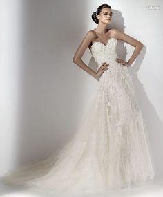 Vestido de novia linea A en encaje bordado.