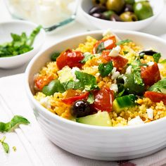 A healthy 20-minute Greek Couscous Salad with feta, tomatoes and mint.