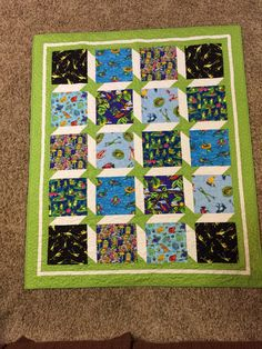 A personal favorite from my Etsy shop https://www.etsy.com/listing/512733905/frogs-and-stars-large-baby-quilt