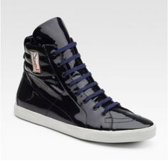 Navy YSL patent leather rolling sneakers ($410).