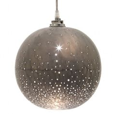 Made of raw iron with a phosphate coating, this hanging pendant at Jayson Home has hand-drilled holes that, when lit, give the appearance of a starry night sky. Sky Lamp, Lamp Light, Light Fixture, Outdoor Pendant Lighting, Home Lighting, Lighting Ideas, Modern Lighting, Starry Night Sky, Beautiful Interior Design
