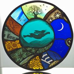 Leaping Hare and Moon painted stained glass panel with antique stained glass fragments. Jess Stroud.