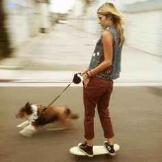 Skateboarding.. Does that mean she's skateboarding the dog, or walking the dog?