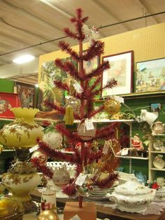Amazing cranberry feather tree from Vendor 889 in booth 187. Priced at $18.00. Available at The Brass Armadillo Antique Mall - WheatRidge, CO! (303) 403-1677.