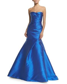 """Monique Lhuillier draped woven ball gown. Approx. length: 57""""L down center front, 68""""L down center back. Strapless sweetheart neckline. Mermaid silhouette; asymmetric pleating on left. Hem falls to fl"""