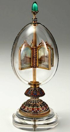 """Easter Egg of the imperial court - """"Egg vraschayuschmisya thumbnail."""" Date of manufacture - 1896. The egg is made of rock crystal and edged stripe, dotted with diamonds. Inside the egg on a gold rotating shaft reinforced with four miniatures in gold within a species of imperial palaces. Miniatures made by Johannes Zengrafom. Presented by emperor Nicholas II, his wife Empress Alexandra Feodorovna on Easter 1896."""