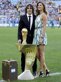 Outshining the trophy: Gisele posed regally with the statuette and the Spanish soccer player