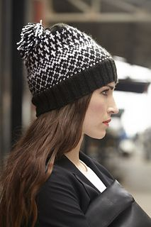 Graphic 2-color hat with ribbed brim. Sized for adult woman and shown on page 74.