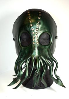 Cthulhu leather mask with tentacles ,Lovecraft inspired dark metallic lime green with gold interference. $99.99, via Etsy.