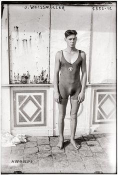 Johnny Weissmuller in an Illinois Athletic Club swimsuit circa 1922, prior to winning five Olympic gold medals in 1924 and 1928. Before becoming Tarzan and signing a movie contract with MGM in 1932, Weissmuller was a spokesmodel for BVD swimwear.