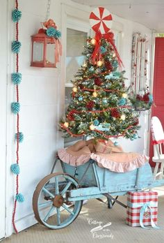 Red and Aqua Christmas Porch NOT my real style - but LOVE this! Retro Red and Aqua Christmas Porch Blue Christmas Decor, Noel Christmas, Modern Christmas, Rustic Christmas, Vintage Christmas, Christmas Ideas, Victorian Christmas, White Christmas, Christmas Decorating Ideas