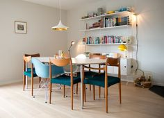 love the mix and match chairs, light fixture, and bookshelves
