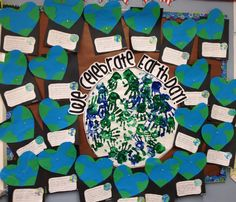 """Kids layer green paper on blue, and cut into heart shape. Write """"I can take care of the earth by"""". Make a handprint earth as a class"""