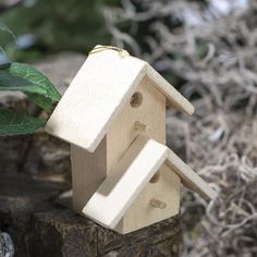 Miniature Unfinished Wood Birdhouse Ornament - $1.29  1 3/4 inches wide 2 inches high 1 1/4 inches deep