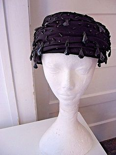 BEAUTIFUL BLACK SATIN IS GATHERED, PLEATED AND IS WRAPPED AROUND STARCHED TULLE. WHICH GIVES THE HAT SUPPORT AND BODY. TINY JET BLACK BEADS AND CUT TEARDROP SHAPED DANGLING BEADS ADORN THE SIDES OF THE HAT. | eBay!