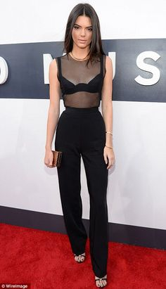 bd498a001abdb Kendall Jenner wore a sheer black top and black trousers that accentuated  her tiny waist at