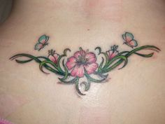 dainty+tribal+lower+back+tattos | Butterflies and flowers tattoo