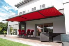 Markilux 1100 over wooden patio furniture