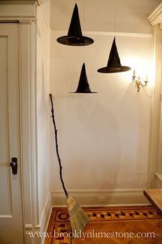Floating witches hats (hung with fishing line) along with a broom...good idea for a front porch for Halloween.