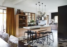This stylish kitchen balances both modern lines and more traditional comforts.  Woven rope kitchen stools by Dark Horse.  #kitchen #design #interior #ideas #stools #woven #black #modern #seating #home South African Design, Interior Design Inspiration, Interior Ideas, Stylish Kitchen, Kitchen Stools, Dark Horse, Simple Pleasures, Modern Furniture, Horses