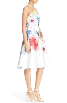 Free shipping and returns on Ted Baker London 'Corpina' Floral Print Fit & Flare Dress at Nordstrom.com. A bright, painterly floral design brightens a fresh white fit-and-flare dress topped with a graceful halter neck perfect for showing off pretty shoulders.