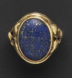 Arts & Crafts 18kt Gold and Lapis Ring, Attributed to Edward Oakes, bezel-set with a low domed oval cabochon lapis, foliate shoulders, size 4 3/4, unsigned.