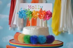 Pom-pom cake at a Rainbow girl birthday party!  See more party ideas at CatchMyParty.com!