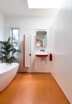 Bathroom. orange floor and sanitaryware