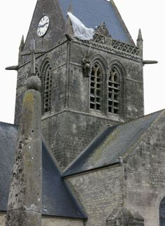 """Normandy, France - Saint Mere Eglise D-Day They still have a """"dummy"""" soldier hanging from the top of the church with his parachute which was was in the movie """"The Longest Day"""" Normandy Beach, Normandy France, D Day, Battleship, Ww2, Places Ive Been, Beaches, Theater, Saints"""