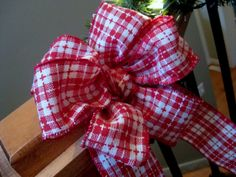 {how to tie a fancy bow} - She makes it sooooo easy!!! I did it after watching!!! Could never tie a bow before!!