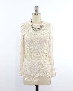 Very delicate and elegant ivory Guipure lace blouse. This item is made of thick crochet like Guipure lace that gives it feminine and vintage look. Fitted design makes this top perfect to pair with skinny jeans and A-line skirts.  - Crew neck - Long Sleeves - Guipurelace (front and back) - Cotton - Non-stretchy - Unlined (wear with or without undershirt)