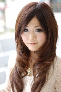asian long hairstyles with side bangs and dark brown hair color for thick wavy women round faces