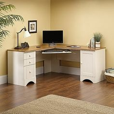 Tired of stuffy-looking L-shaped desks? This one has some character, with its melamine-finished wood top, stylish moldings, and antique white base. It also offers a generous file drawer, built-in wire