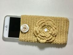 Yellow crochet pouch. I phone 6 plus fits inside nicely with its protective case. Will also hold other phones of similar size. About 4 inches wide, 6.5 inches high.  Body made out of high quality wool. Button is made out of wood. Large sewn in crocheted flower in front. Plain back. This pouch can also work as make up pouch to keep all those little items together in purse. Or sunglasses pouch.