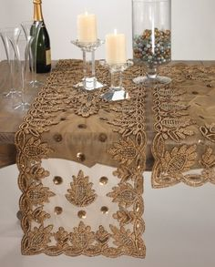 """Elegant Lakshmi Hand Beaded Gold Table Runner. 16""""x72"""" Rectangular. One Piece. by Fennco. $63.68. Made of 100% polyester. Machine washable; imported. Measures 16 inch by 72 inch. Original Price: $147. This beautiful table runner hand beaded in lakshmi design will add a luxurious touch to your seasonal table.. Save 57%!"""