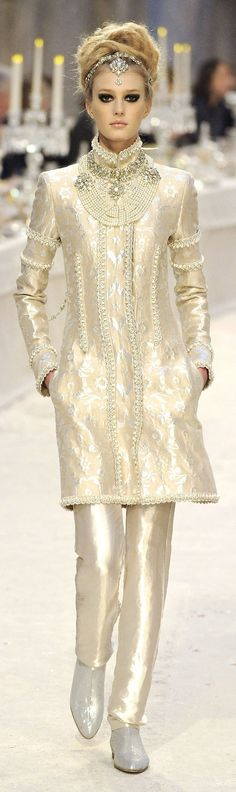 Chanel. It somehow reminds me of both baroque and Indian classic designs.