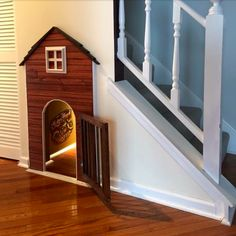 An absolutely awesome idea ! This owner converted the unused space under his staircase into a doghouse for his dog by adding drywall and insulation, painting, and decorating.