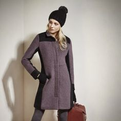 JILL Wool mix coat. Full-length coat with contrast panels. Hidden button front and slash pockets. Made from wool and recycled polyester blend fabric.