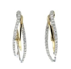These beautiful hoop earrings feature both yellow and white gold. Diamonds line the white gold adding glitz and interest!