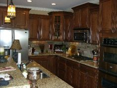 Google Image Result for http://assets.davinong.com/images/entry/2011/06/26/1526/stone-backsplash-in-kitchen.jpg