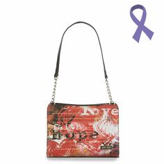 Red and black graphic print with words of hope and black accents. Side pockets. Petite #5126- $18.95. Must have base bag. This is a Shell Only. All handles are interchangeable. Click here for more information: https://OnDaGoPurses.miche.com. A Portion of the proceeds go towards CANCER RESEARCH.