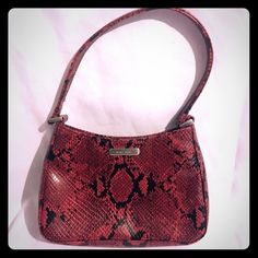 """Nine West Purse Red and black faux snake skin purse. Has one small pocket on the inside. W/out strap: 6"""" x 8"""" W/ strap: 12"""" x 8"""" hardly used so no major signs of wear. Nine West Bags Mini Bags"""
