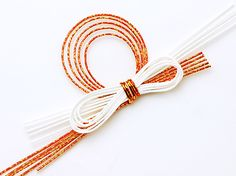 Mizuhiki  Mizuhiki is an ancient Japanese art form that uses a special cord. The cord is created from rice paper, that is tightly wound, starched to give it stiffness, and then colored.