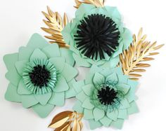 Set of 6 paper flowers and leaves.  Beautiful paper flower backdrop. Perfect for weddings, events, showers, birthdays and home decor.  Flowers include: 2 - 18 1 - 12 3 - 6  Send a message with your color choice upon checkout.  I welcome custom orders