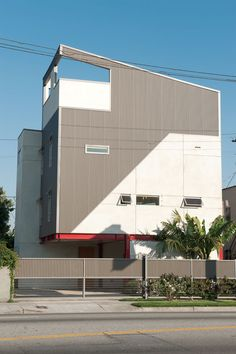 Cost-effective modern home with corrugated sheet metal facade.