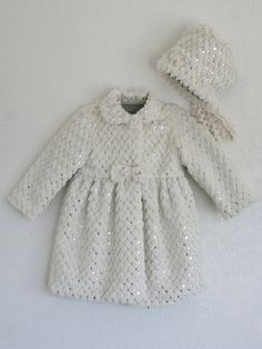 Sparkling Sequins Baby Coat  |  Use the code DZNMOM15, to get 15% off at Isabel Garretón, expires 12/31.