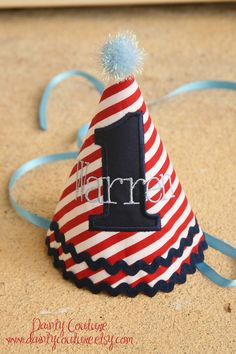 Boys 1st Birthday Party Hat - Stunning 4th of July stripes in red, white, and blue - Free personalization. $25.00, via Etsy.